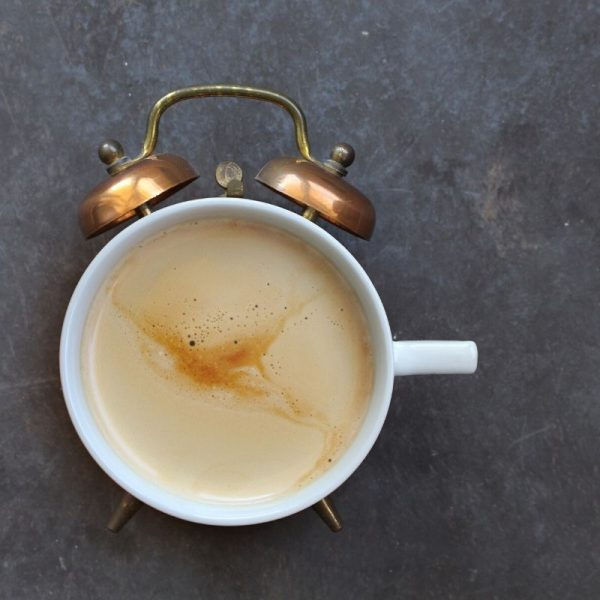 cup of coffee that looks like an alarm clock